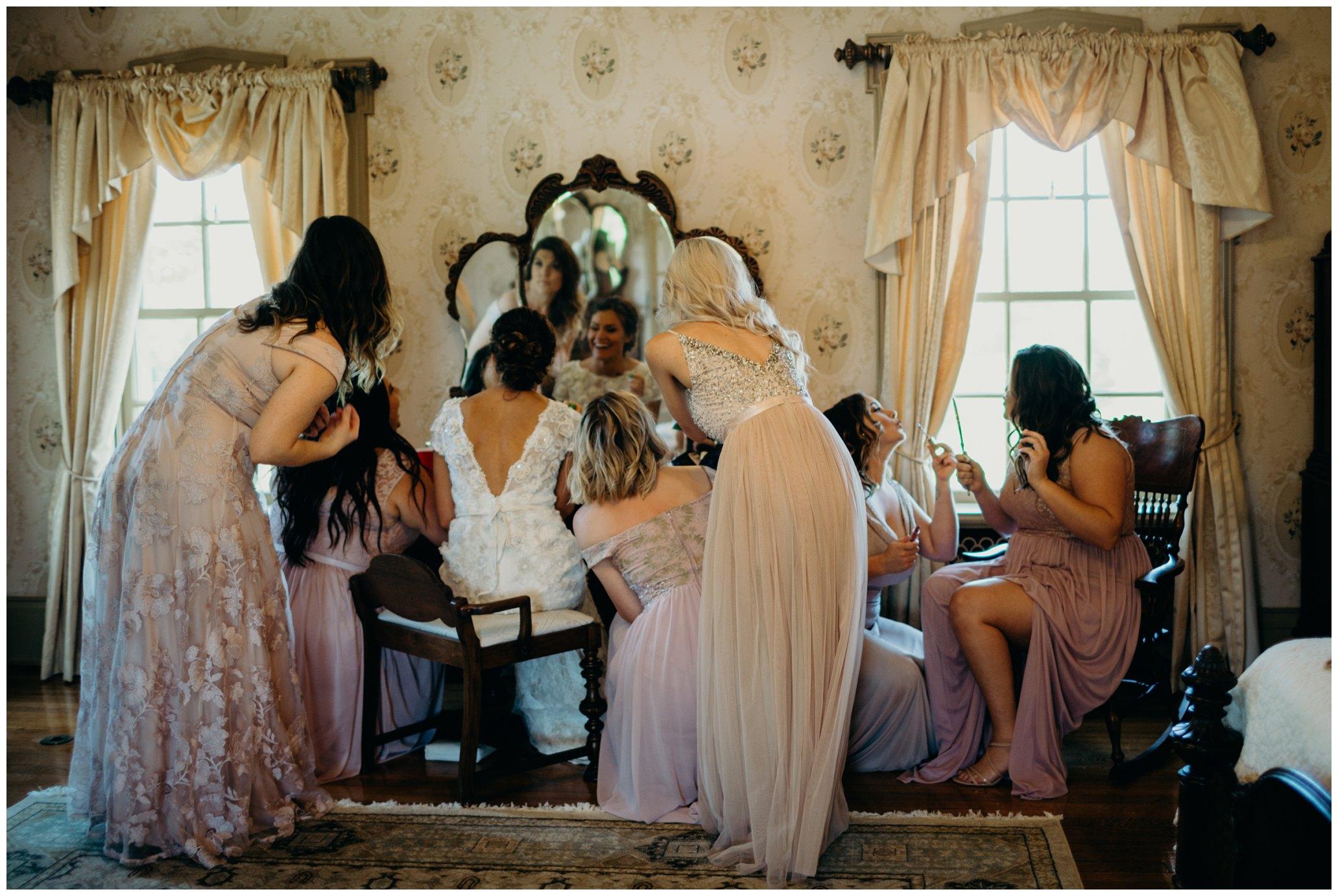 Bridesmaids getting ready at felt mansion